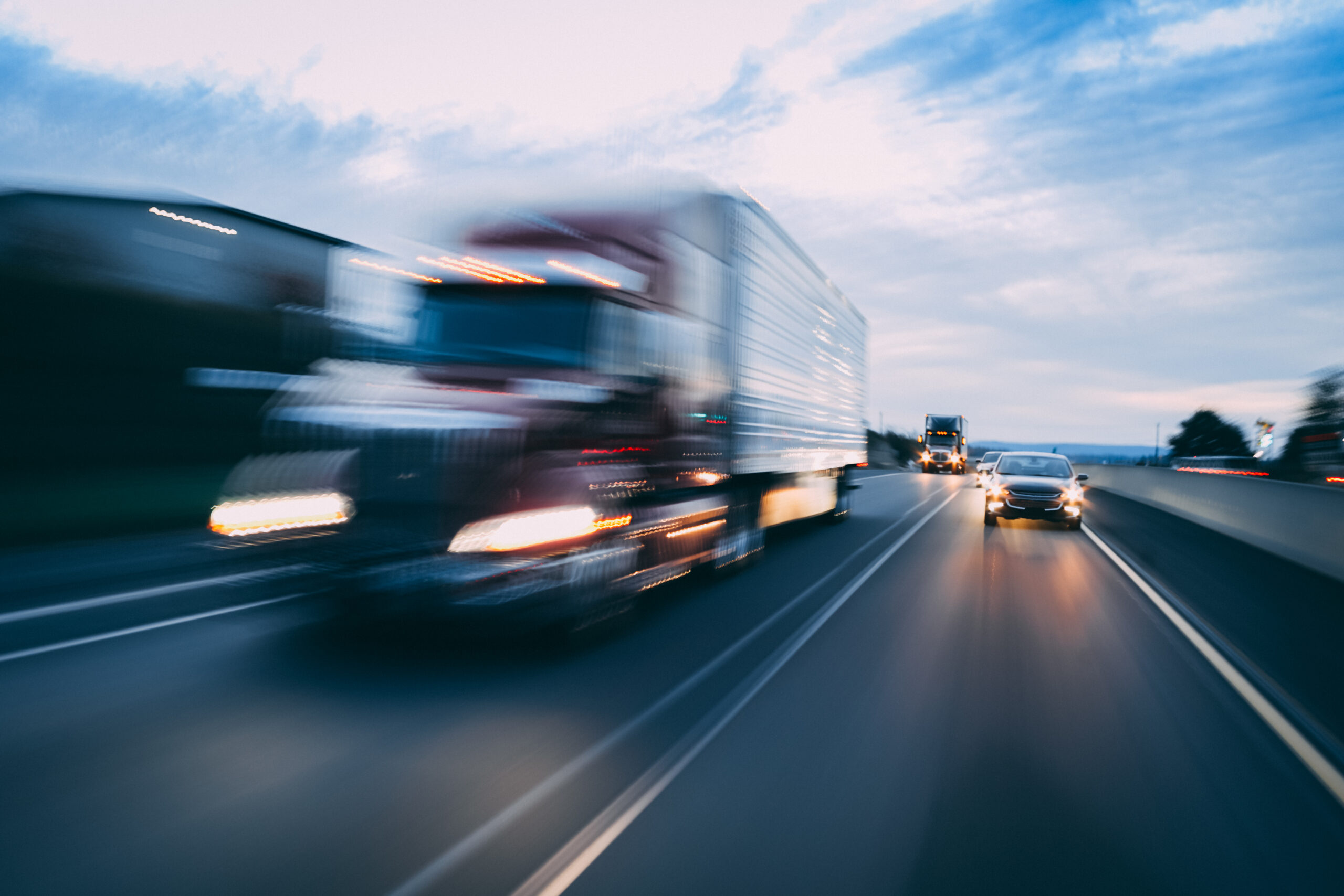 Big rig 18-wheeler semi-truck motion blur transportation concept